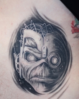 Grey Ink Robot Mummy Head Tattoo