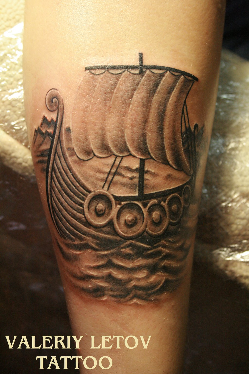 Grey Ink Sailing Viking Ship Tattoo