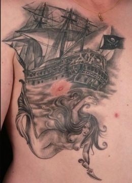 Grey Ink Ship And Mermaid Tattoos On Chest
