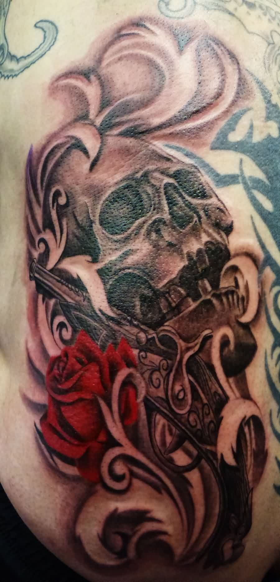 Grey Ink Skull Gun And Rose Tattoos
