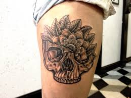 Grey Ink Skull Tattoo On Side Of Thigh
