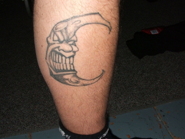Grey Ink Wicked Moon Tattoo On Leg