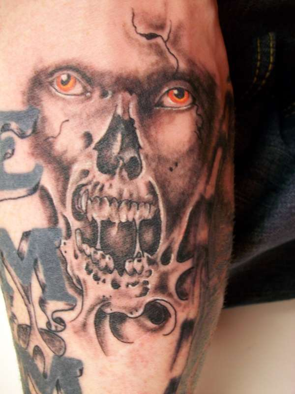 Grey Ink Wicked Skull Tattoo