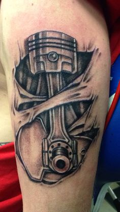 Grey Piston Tattoo On Muscles