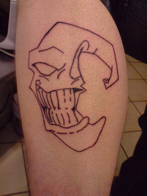Grinning Moon Outline Tattoo On Leg