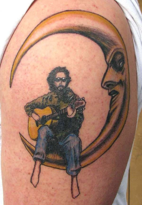 Guy Playing Guitar On The Moon Tattoo