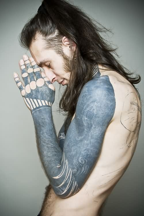 Guy With Long Hairs And Left Sleeve Tattoos