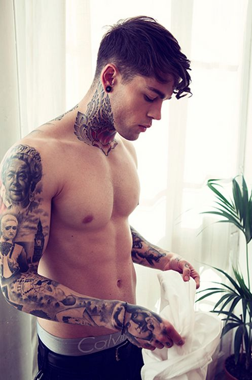 Guy With Neck And Sleeve Tattoos