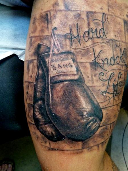 Hard Knock Life Boxing Gloves Tattoo On Muscles