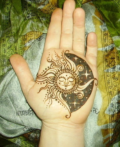 Henna Sun And Moon Tattoos On Palm Of Hand