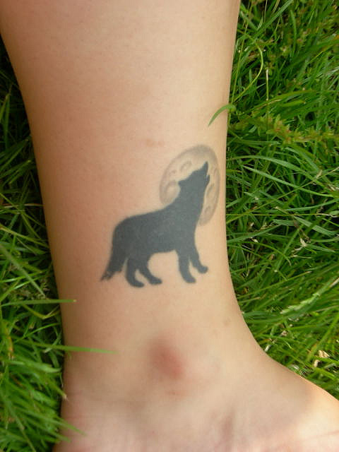 Howling Wolf  At Full Moon Tattoo On The Ankle