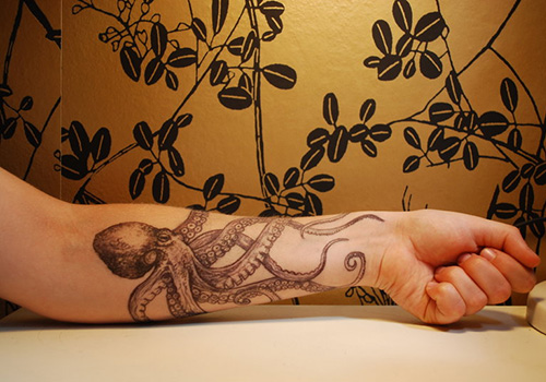Impressive Grey Octopus Tattoo On Forearm