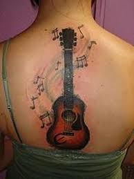 Impressive Music Tattoos On Upperback