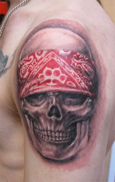 Incredible Grey Ink Skull Tattoo On Shoulder