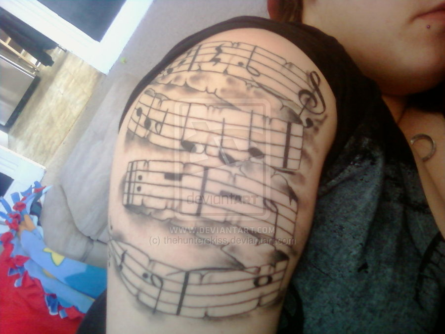 Incredible Music Sheet Tattoo On Shoulder For Women
