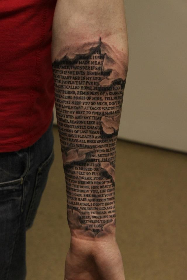 Incredible Newspaper Ripped Skin Tattoo On Forearm