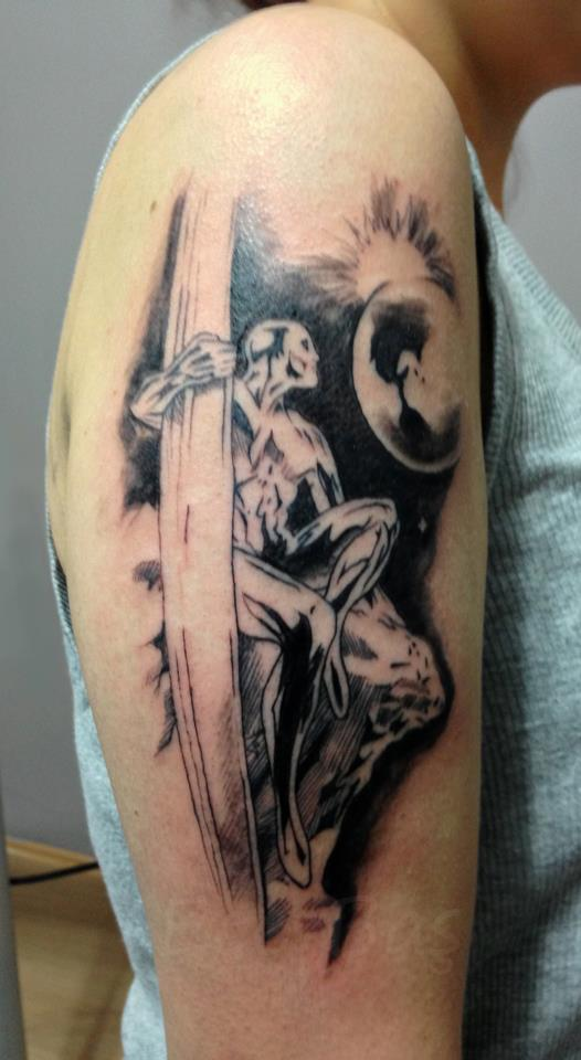 Incredible Silver Surfer Tattoo On Biceps