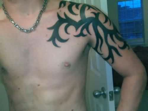 Incredible Tribal Shoulder Tattoo For Men