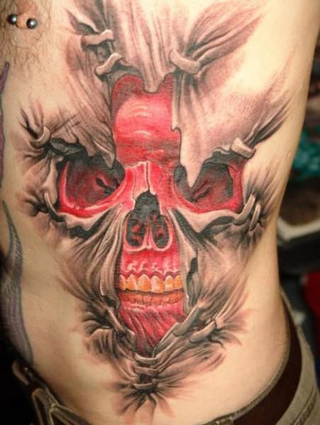 It's A Massive 3D Style Red Skull Ripping Out Skin Tattoo On Side