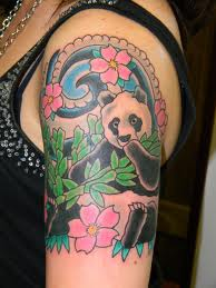 Japanese Style Panda And Pink Flower Tattoos On Upper Arm