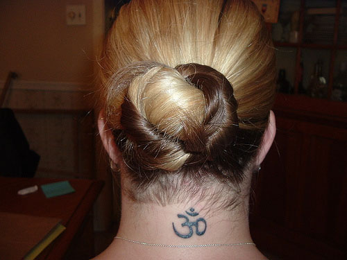 Juda Hairstyle And Holy Neck Tattoo For Women