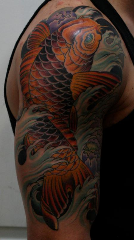 Koi With Blue Waves Tattoo On Right Muscles
