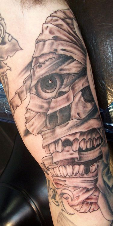 Large Grey Mummy Head Tattoo On Arm