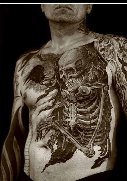 Large Ripped Skin Skeleton Tattoo On Chest