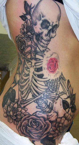 Large Skeleton And Flowers Tattoos On Ribs