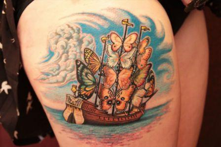 Lovely Butterfly Ship Tattoo On Upper Thigh