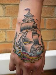Lovely Colorful Pirate Ship Tattoo On Hand