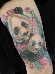 Lovely Panda With Pink Flower Tattoos On Arm