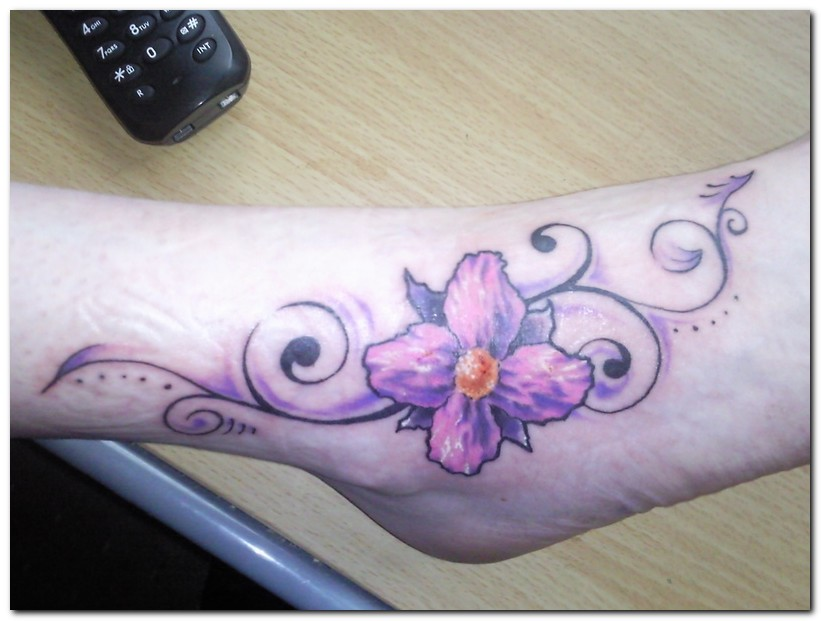 Lovely Purple Orchid Flower Tattoo On Ankle