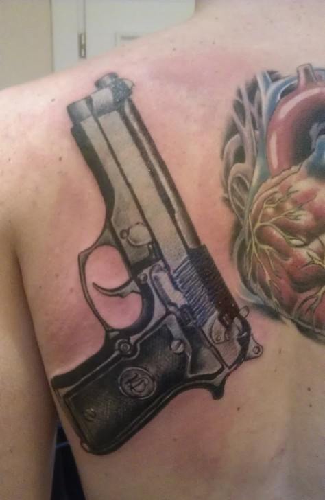 9mm Pistol And Red Heart Tattoos