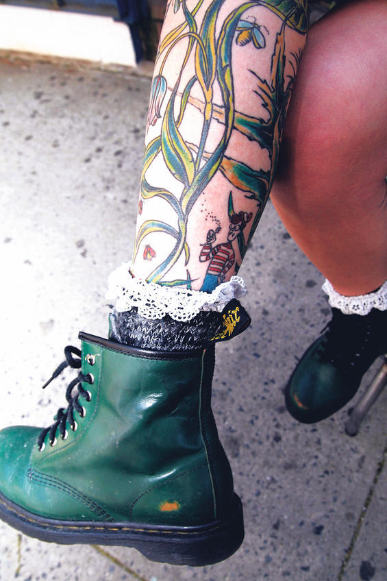 A Cleverly Placed Wheres Waldo Tattoo That Has Waldo Peeking Out Of The Top Of The Girls Sock