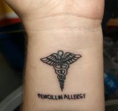 A Small Medical Symbol Tattoo On Inner Wrist