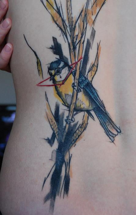 A Watercolor Painting Becomes An Abstract Body Art Work In This Tattoo Of A Bird On A Reed