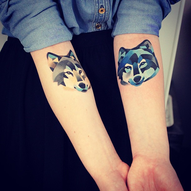 Abstact Wolf Head Tattoos On Forearms
