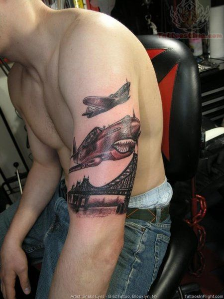 Airhawks Flying Over Bridge Tattoo On Arm
