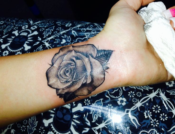 Alluring Grey Rose Tattoo On Inner Wrist