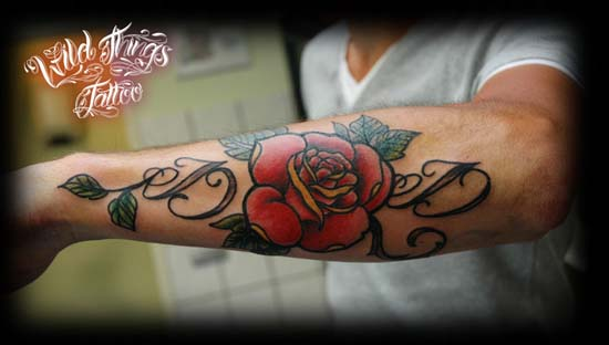 Alphabet D And Red Rose Tattoos On Arm