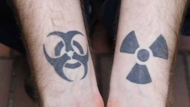 Amazing Black Biohazard Symbol Tattoo On Right Arm