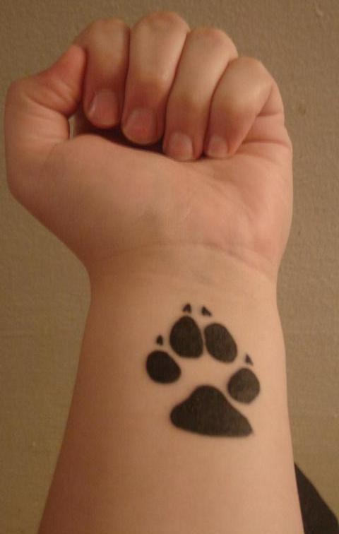 Amazing Black Paw Print Tattoo On Inner Wrist