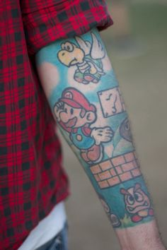 Amazing Colorful Video Game Tattoos On Arm