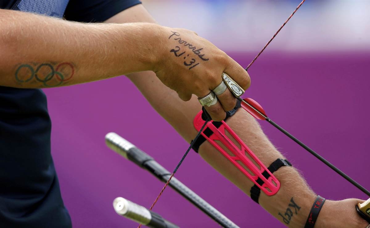 Amazing Olympic Logo Tattoo On Arm Of Archer