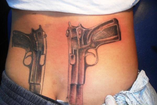Amazing Pistols Tattoos On Back Waist
