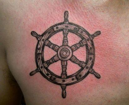 Amazing Wooden Ship Wheel Tattoo On Chest