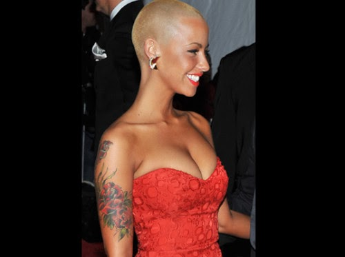Amber Rose With Red Rose Tattoos On Arm