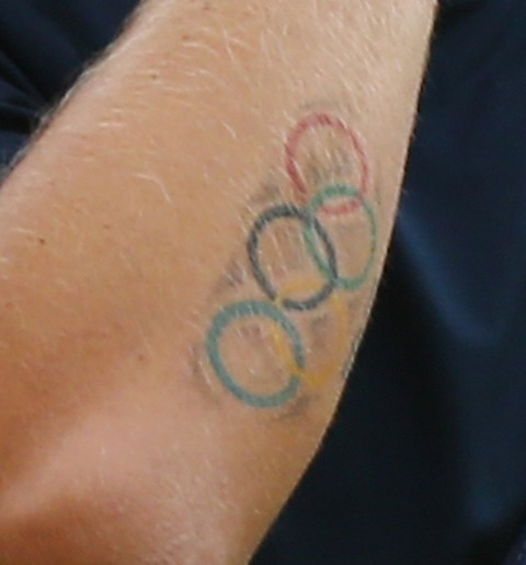 An Olympic Tattoo On Arm