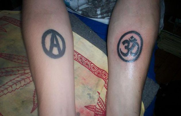 Anarchy And Ohm Symbol Tattoos On Forearm